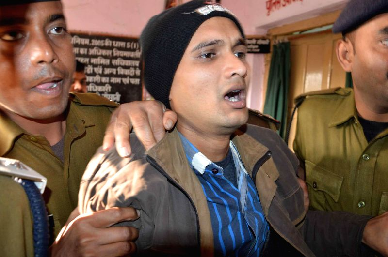 A 22-year old. who hails from Bihar's Chapra district being presented before press by police after he hurled a shoe at Bihar Chief Minister Jitan Ram Manjhi during Janata Darbar at Chief ... - Jitan Ram Manjhi