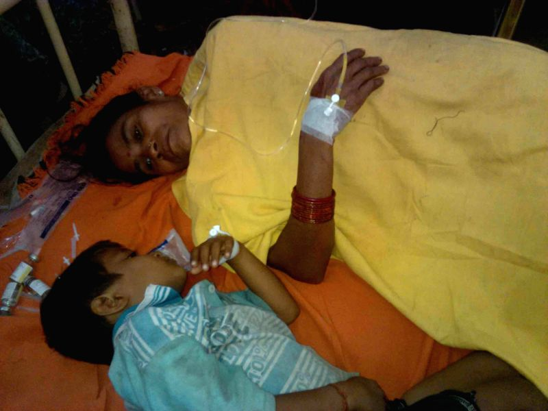 A child undergoes treatment at Sadar hospital in Hajipur of Bihar's Vaishali district on Feb 19, 2015. At least 30 children fell ill after having the meal.