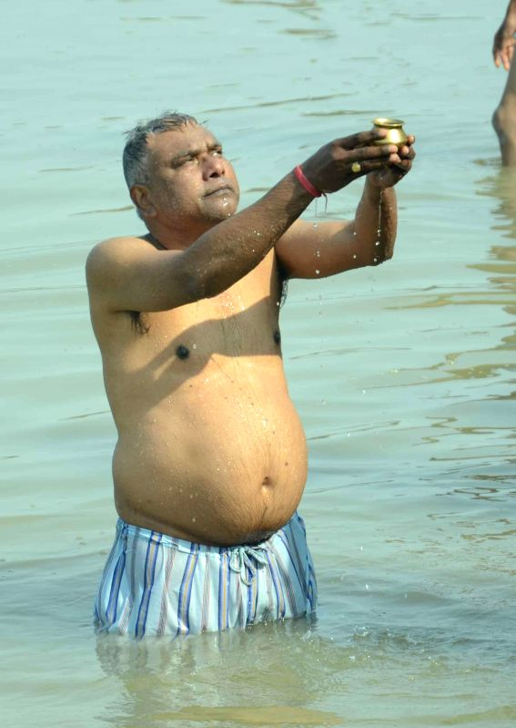 A man performs rituals in the Ganga river on Makar Sankranti in Patna, on Jan 14, 2015.