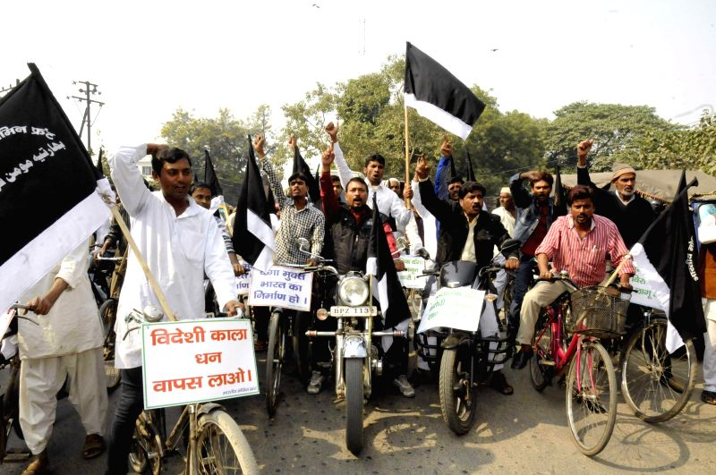 Activists demonstration against to bring back black money stashed in foreign banks and to introduce communal violence bill in Patna, on Nov 22, 2014.