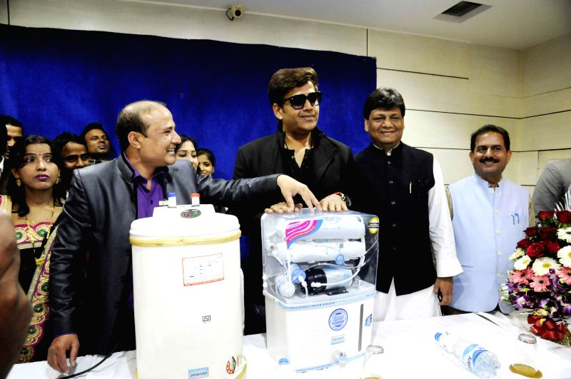 Actor Ravi Kishan during the launch of Aqua Solar Water Purification in Patna on Feb. 4, 2015.