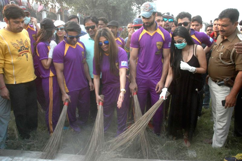 Actress Rakhi Sawant participates in Clean India Campaign on the eve of World Toilet Day in Patna, on Nov 18, 2014.