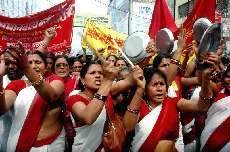 Anganwadi workers stage a demonstration to press for their demands in Patna, on March 9, 2015.