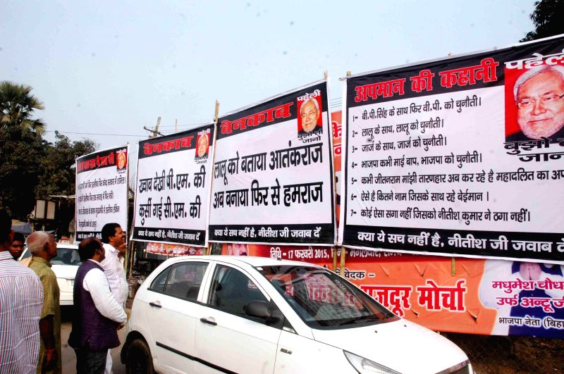 Anti-Nitish posters come up in Patna on Feb 20, 2015.