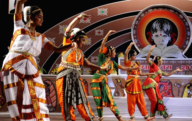 Artists perform during  a programme organised on National Education Day in Patna, on Nov 11, 2014.