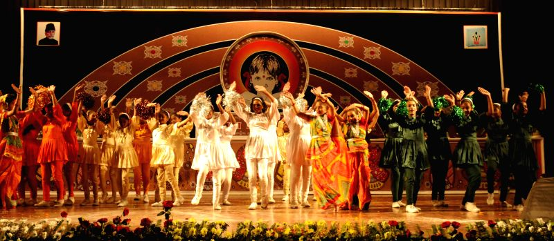 Artists perform during a programme organised to celebrate National Education Day in Patna.