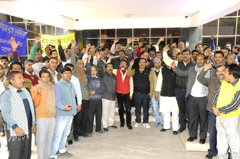 Bank employees stage a demonstration in front of a bank to press for their various demands in  Patna, on Dec 4, 2014.