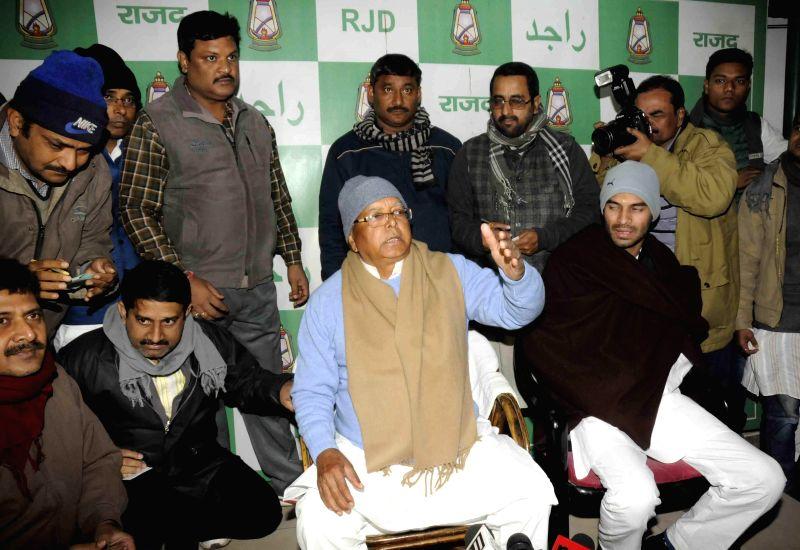 Bengaluru: RJD supremo Lalu Prasad Yadav addresses a press conference in Patna on Dec 30, 2014. - Lalu Prasad Yadav