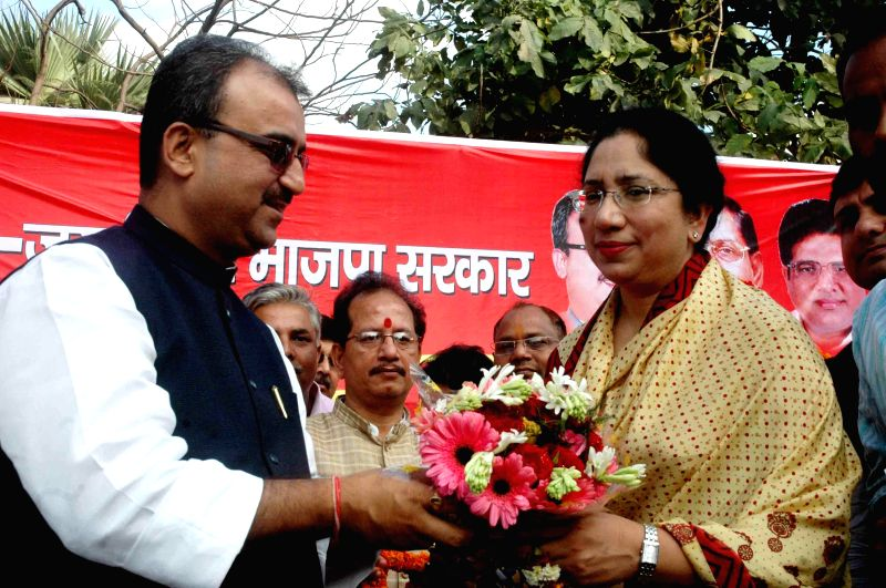 Bihar BJP chief Mangal Pandey welcomes Congress leader Vineeta Vijay in BJP during a programme on March 3, 2015. - Mangal Pandey