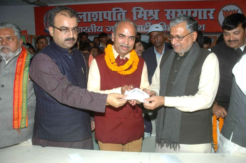 Bihar BJP chief Mangal Pandey with party leader Sushil Kumar Modi during a programme organised to induct new members in Patna on Dec 10, 2014.