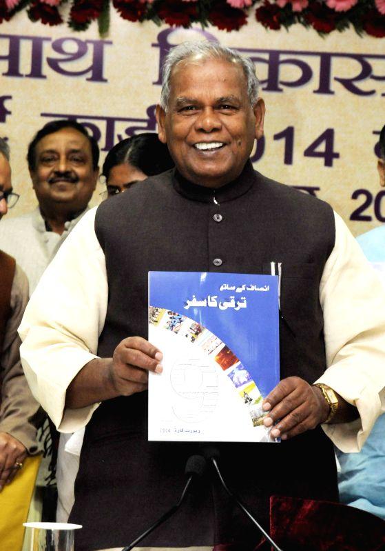 Bihar Chief Minister Jitan Ram Majhi releases report card of nine years of JD (U) rule in Bihar, in Patna on Nov 25, 2014. - Jitan Ram Majhi