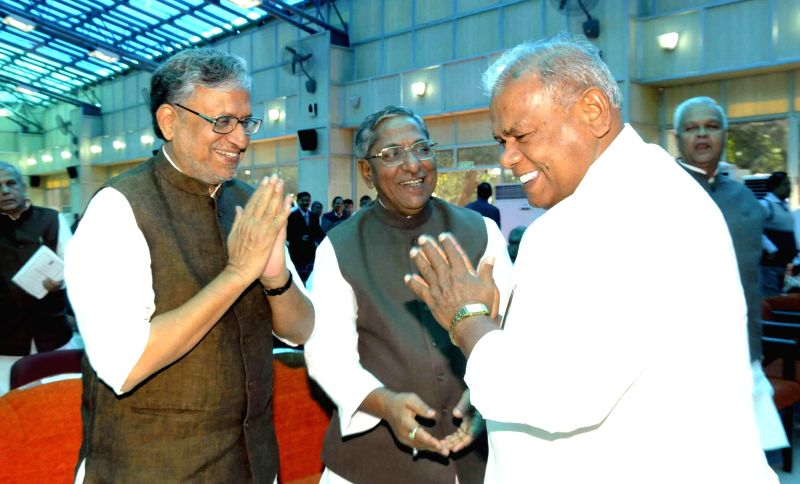 Bihar Chief Minister Jitan Ram Majhi and BJP leader Sushil Kumar Modi during a programme where West Bengal Governor Keshari Nath Tripathi took additional charge as Bihar Governor until a new .. - Jitan Ram Majhi, Sushil Kumar Modi and Keshari Nath Tripathi