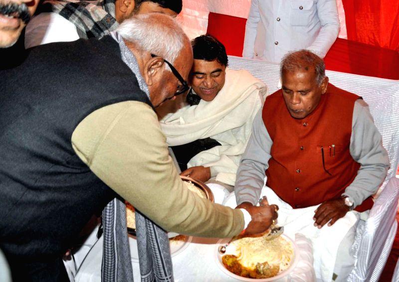 Bihar Chief Minister Jitan Ram Majhi during a feast organised on Makar Sankranti at the RJD supremo Lalu Prasad Yadav's residence in Patna, on Jan 14, 2015. - Jitan Ram Majhi and Lalu Prasad Yadav