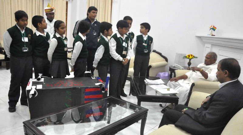 Bihar Chief Minister Jitan Ram Majhi meets students of a Patna school in Patna, on Nov 28, 2014. - Jitan Ram Majhi