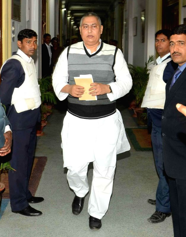 Bihar Chief Minister Jitan Ram Majhi with Bihar Ministers Vinay Bihari and Narendra Singh come out after a cabinet meeting in Patna on Feb 10, 2015. - Jitan Ram Majhi, Vinay Bihari and Narendra Singh
