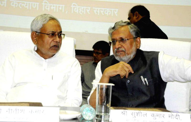":Patna: Bihar Chief Minister Nitish Kumar and Deputy Chief Minister Sushil Kumar Modi at the launch of ""Mukhyamantri Kanya Utthan Yojana"", in Patna, on  Aug 3, 2018 (Photo: IANS)."