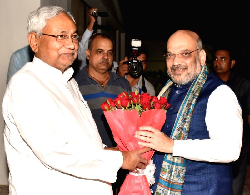 : Patna: Bihar Chief Minister Nitish Kumar greets BJP Chief Amit Shah during a dinner party at his official residence in Patna on July 12, 2018. (Photo: IANS).