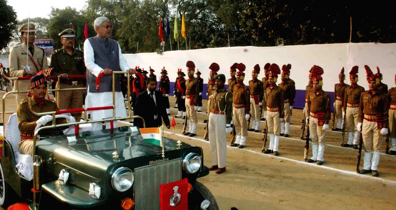 Bihar Chief Minister Nitish Kumar inspects guard of honour during the Police Day programme in Patna, on Feb 27, 2015.
