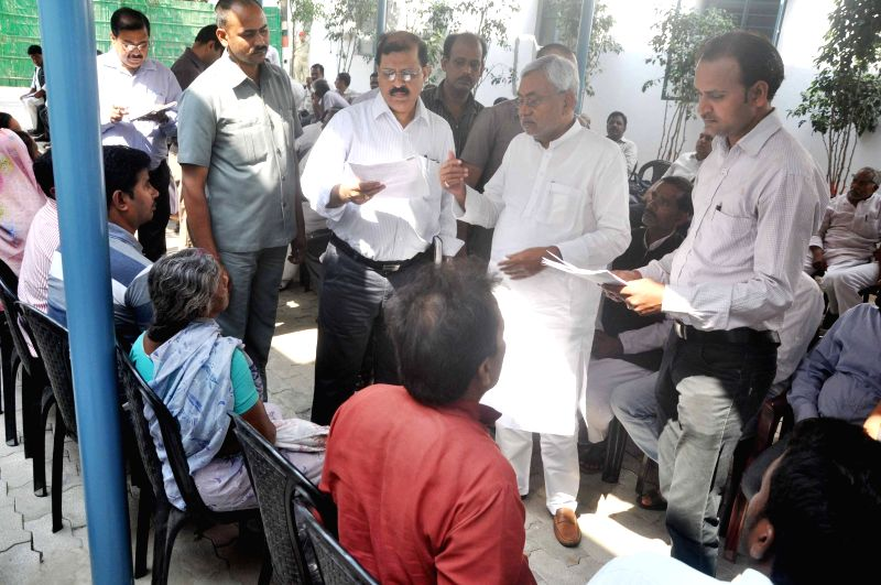 Bihar Chief Minister Nitish Kumar listens to public grievance at his residence in Patna, on March 25, 2015.