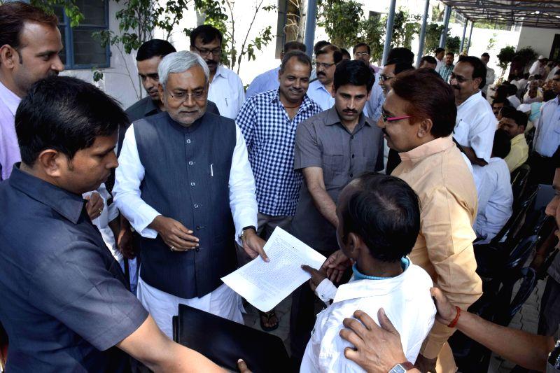 Bihar Chief Minister Nitish Kumar meets people during Janata Durbar in Patna on March 20, 2015.
