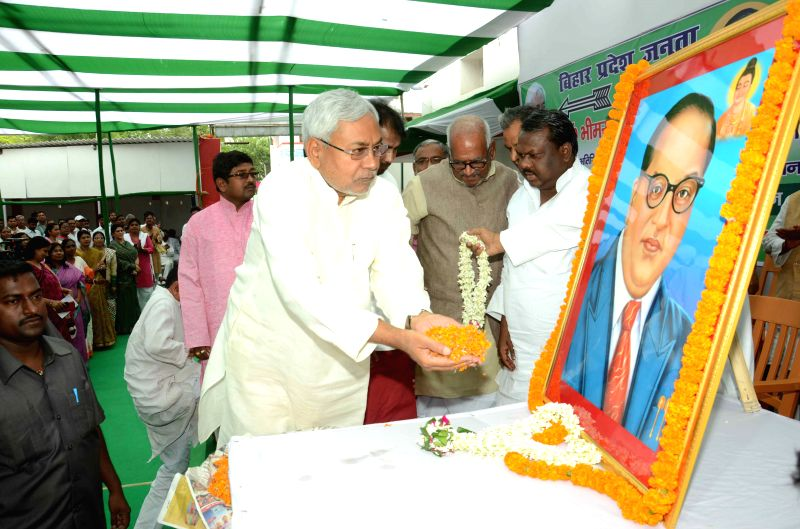 Bihar Chief Minister Nitish Kumar pays tribute to Dr. B. R. Ambedkar on his birth anniversary in Patna on April 14, 2015.