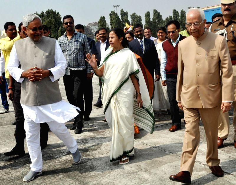 Bihar Chief Minister Nitish Kumar sees-off  West Bengal Chief Minister Mamata Banerjee and the Governor of Bengal and Bihar Keshari Nath Tripathi at Patna Airport on Feb 23, 2015. - Nitish Kumar and Keshari Nath Tripathi