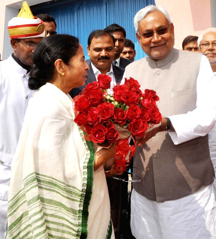 Bihar Chief Minister Nitish Kumar sees-off  West Bengal Chief Minister Mamata Banerjee at Patna Airport on Feb 23, 2015. - Nitish Kumar