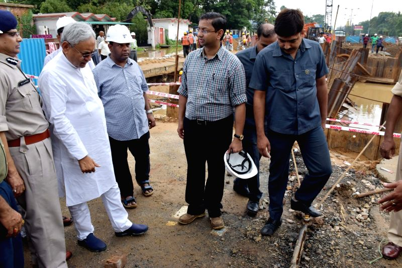 :Patna: Bihar Chief Minister Nitish Kumar visits the spot where a portion of Patna's Bailey road caved-in on July 29, 2018.The road, considered the life line of Bihar capital, caved in due to ...