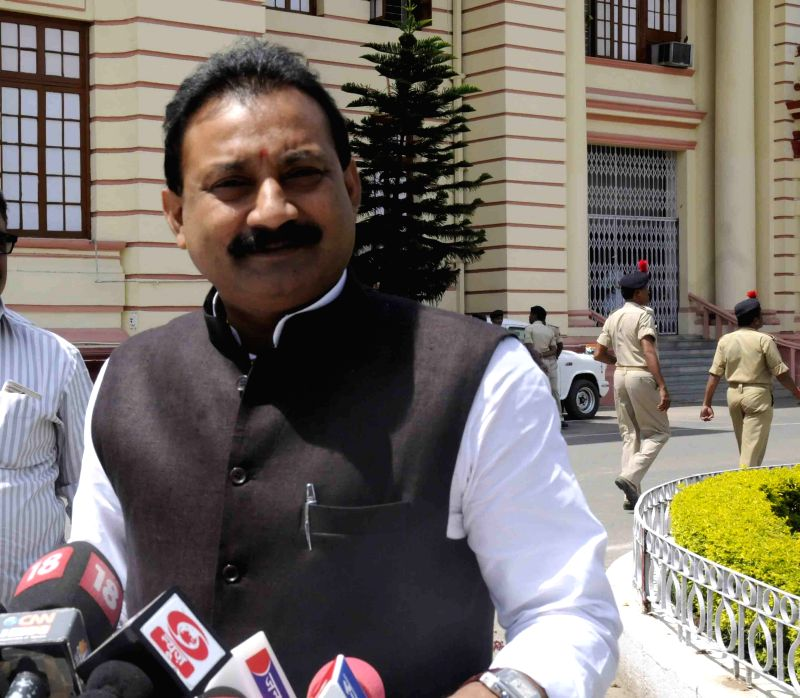 Bihar Congress chief Ashok Chaudhry talks to press at state assembly in Patna on April 6, 2015.