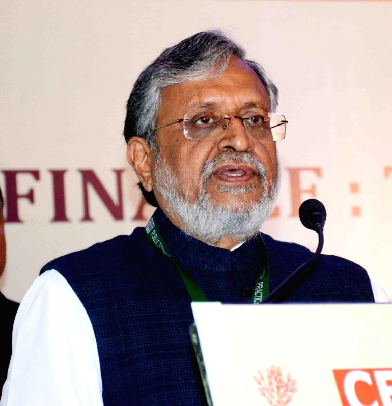 """Patna: Bihar Deputy Chief Minister Sushil Kumar Modi addresses at International Conference on """"Public Finance: Theory, Practice And Challenges"""" in Patna, on Dec 7, 2018."""