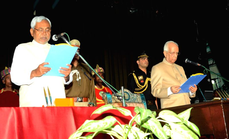 Bihar Governor Keshari Nath Tripathi administers oath of office to Bihar Chief Minister designate Nitish Kumar during a swearing-in ceremony at Raj Bhavan in Patna, on Feb 22, 2015. - Keshari Nath Tripathi