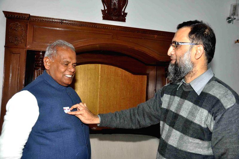 Bihar's Principal Secretary (Home) Amir Subhani with Bihar Chief Minister Jitan Ram Majhi during a meeting in Patna, on Dec 5, 2014. - Jitan Ram Majhi