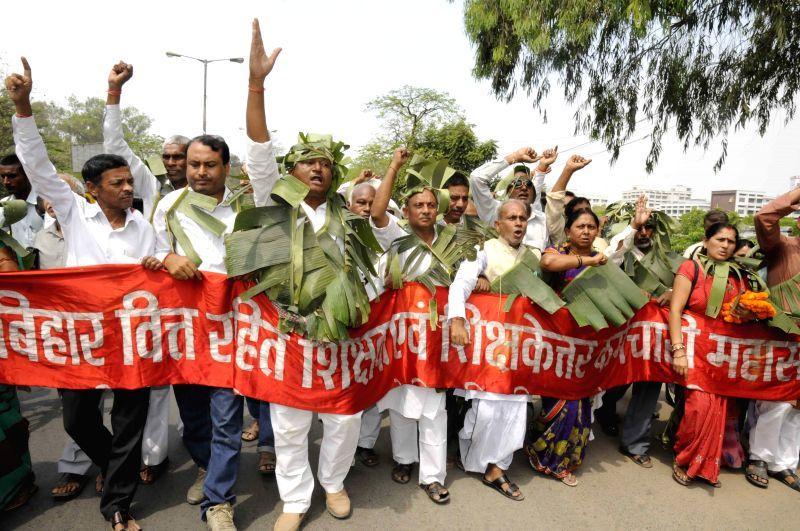 Bihar teachers stage a demonstration near Patna High Court in Patna, on April 14, 2015.