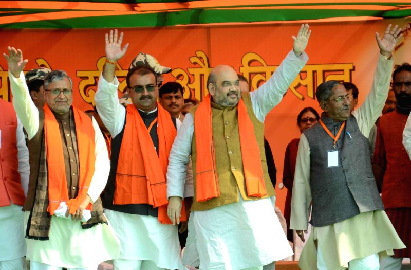 BJP chief Amit Shah with party leader Sushil Kumar Modi, Bihar BJP chief Mangal Pandey and others during a party rally in Patna on Jan 23, 2015. - Amit Shah, Sushil Kumar Modi and Mangal Pandey