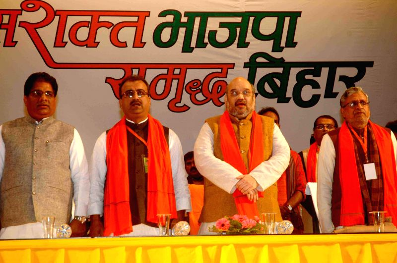 BJP chief Amit Shah with party leader Sushil Kumar Modi, Bihar BJP chief Mangal Pandey and others during a party meeting in Patna on Jan 23, 2015. - Amit Shah, Sushil Kumar Modi and Mangal Pandey