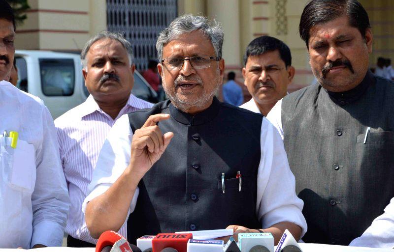 BJP leader Sushil Kumar Modi addresses press at the Bihar assembly in Patna, on April 8, 2015.
