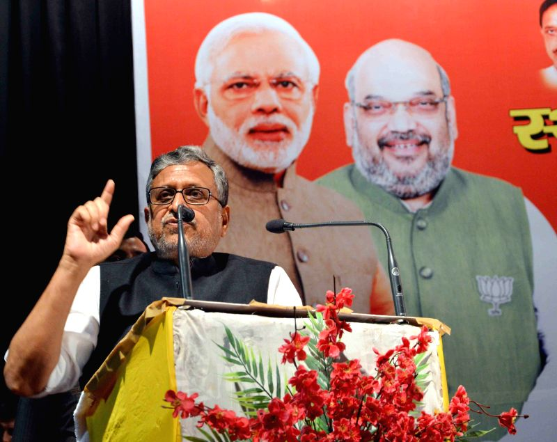 BJP leader Sushil Kumar Modi addresses during a party programme in Patna, on June 18, 2015. - Sushil Kumar Modi