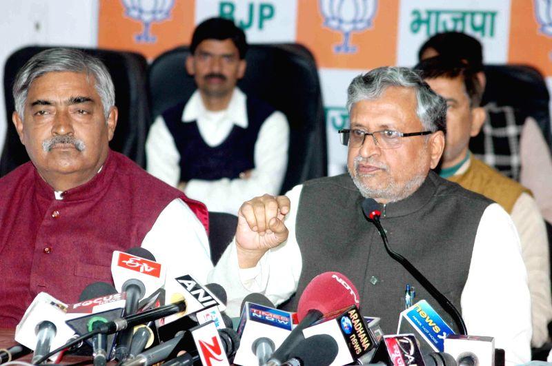 BJP leader Sushil Kumar Modi addresses a press conference in Patna on Feb 17, 2015. - Sushil Kumar Modi