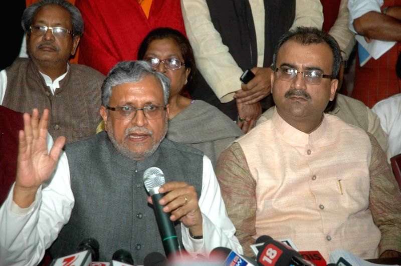 BJP leader Sushil Kumar Modi addresses a press conference in Patna, on Feb 19, 2015.