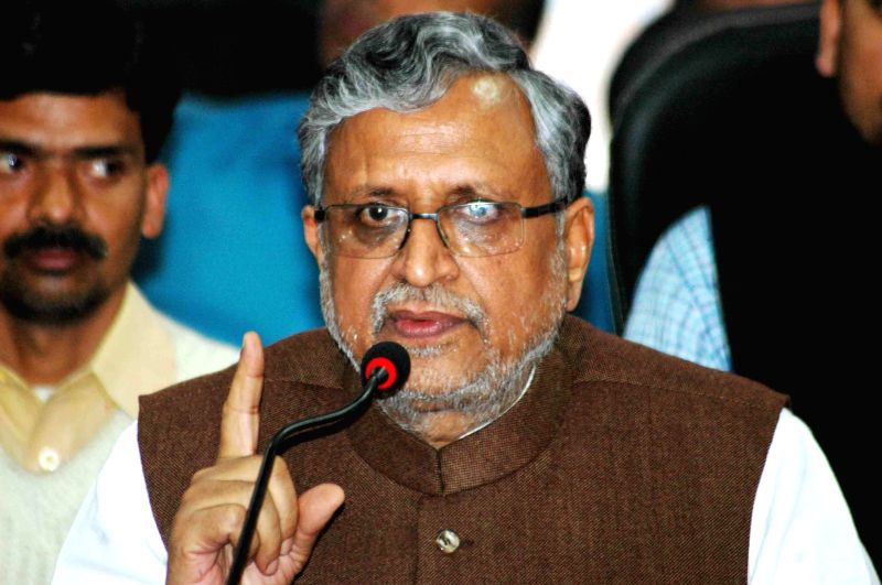 BJP leader Sushil Kumar Modi addresses a press conference in Patna, on Feb 20, 2015.