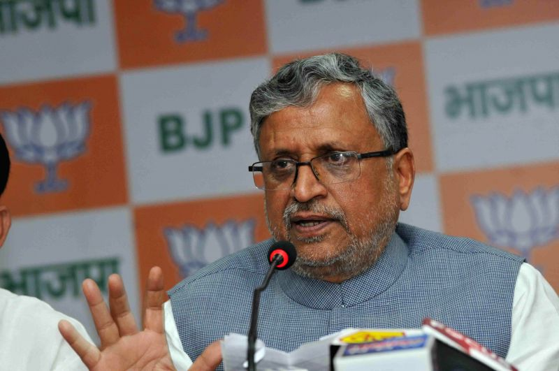 BJP leader Sushil Kumar Modi addresses a press conference in Patna, on Feb 23, 2015. - Sushil Kumar Modi