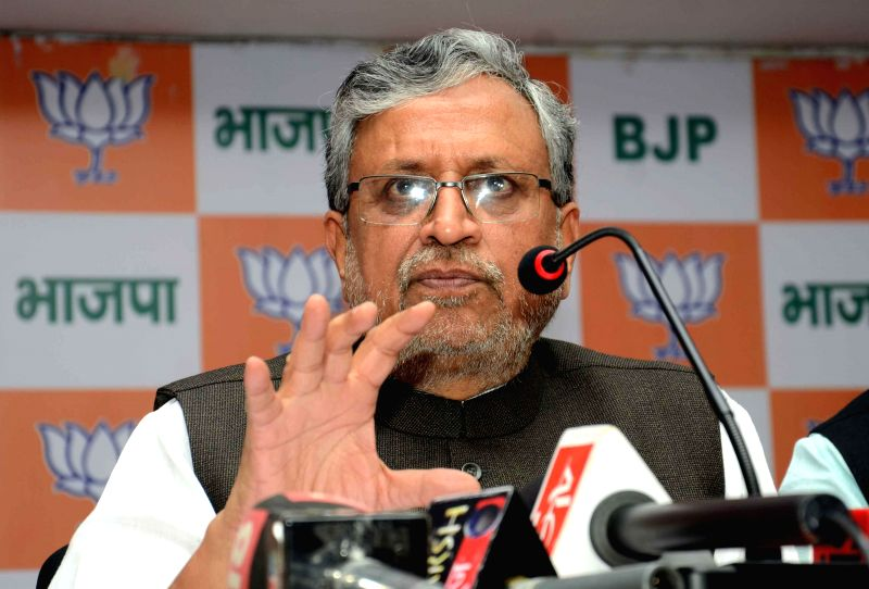 BJP leader Sushil Kumar Modi addresses a press conference in Patna on Feb 27, 2015.