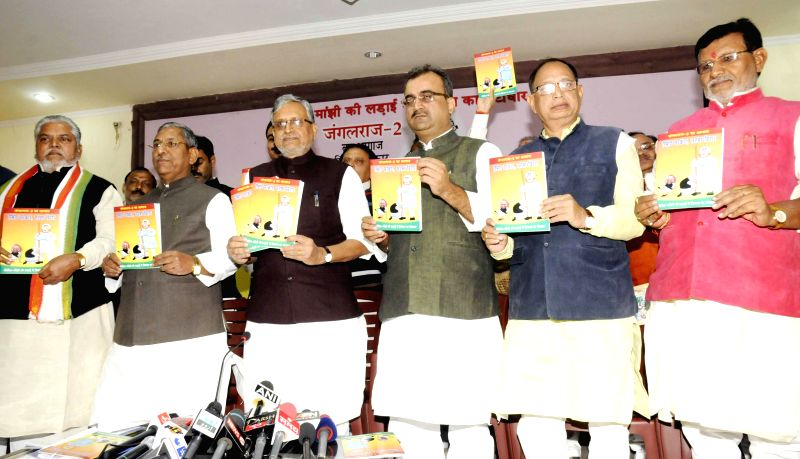 BJP leader Sushil Kumar Modi, Bihar BJP chief Mangal Pandey and others releases report card of Bihar Government in Patna  on Nov 26, 2014. - Sushil Kumar Modi and Mangal Pandey