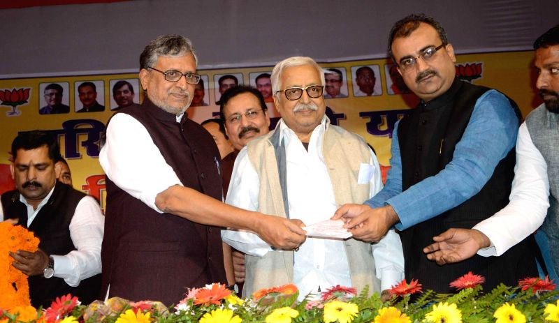 BJP leader Sushil Kumar Modi, Bihar BJP chief Mangal Pandey and others during a programme in Patna, on Nov 30, 2014. - Sushil Kumar Modi