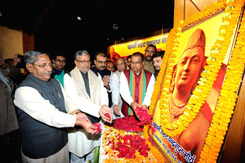BJP leader Sushil Kumar Modi pays tribute to Chandragupta Maurya - the founder of the Maurya Empire during a programme in Patna on Dec 9, 2014. - Sushil Kumar Modi