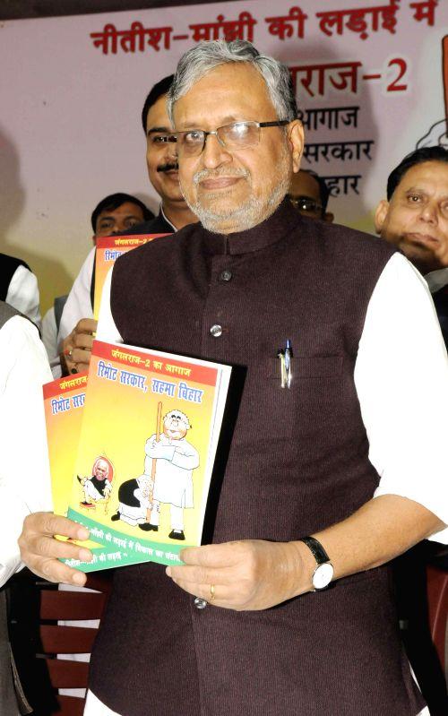 BJP leader Sushil Kumar Modi releases report card of Bihar Government in Patna  on Nov 26, 2014. - Sushil Kumar Modi
