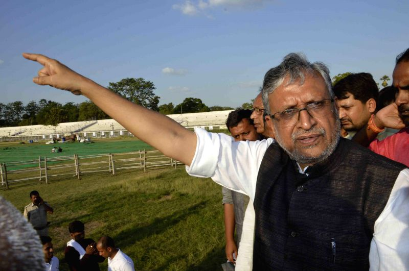 BJP leader Sushil Kumar Modi take stock of the ongoing preparations for ``International Yoga Day`` celebration which will be held on 21st June at Moin-Ul-Haq Stadium in Patna on June 20, 2015.
