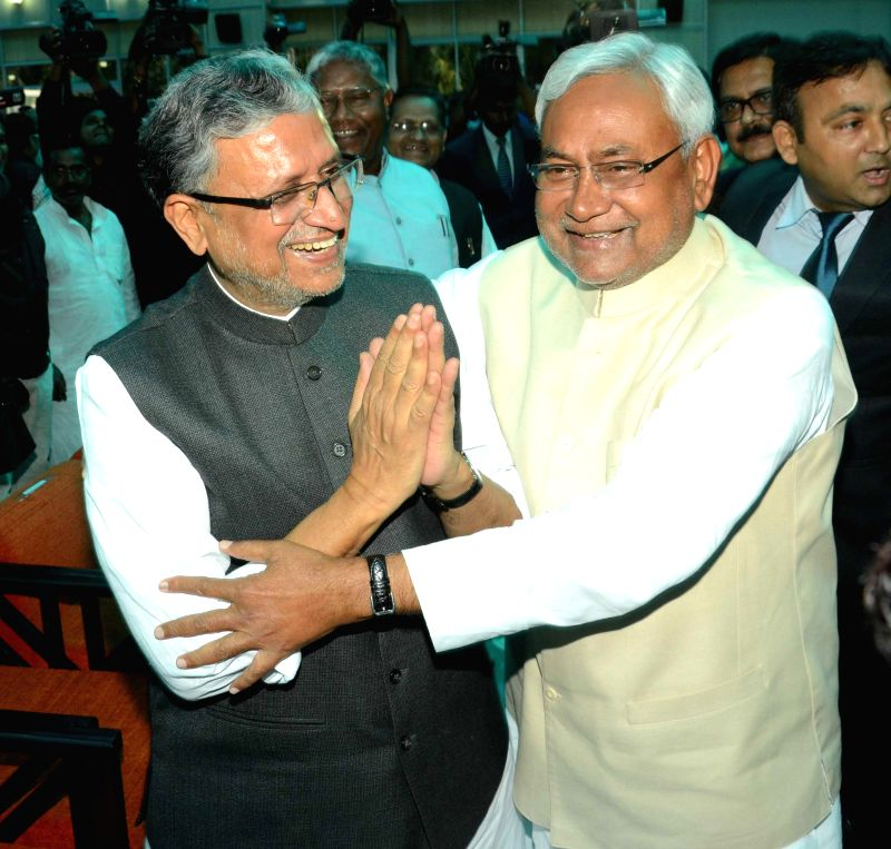 BJP leader Sushil Kumar Modi with JD(U) leader Nitish Kumar during his swearing-in ceremony as the chief minister of Bihar at Raj Bhavan in Patna on Feb 22, 2015.