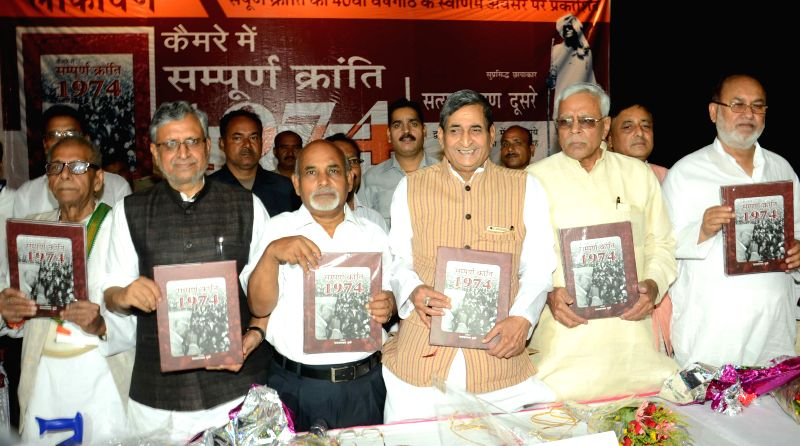 BJP leaders including Sushil Kumar Modi launch photographer Satya Narayan Dusre's photo book on 1974 Sampoorna Kranti  (Total Revolution Movement of 1974) in Patna, on June 5, 2015. - Sushil Kumar Modi