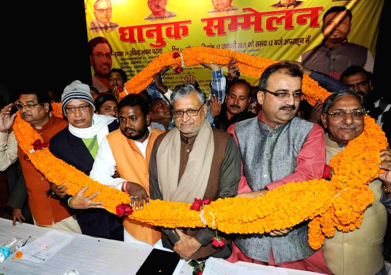 BJP leaders Sushil Kumar Modi, Mangal Pandey and others during a progrmme in Patna on Jan 12, 2015. - Sushil Kumar Modi and Mangal Pandey